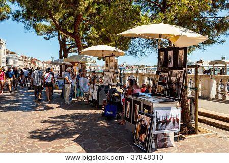 ITALY, VENICE - JULY 2012: - Vendor selling tourist souvenirs on July 16, 2012 in Venice. Most vendo