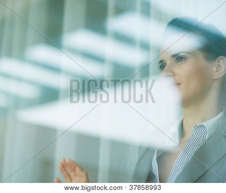 Portrait Of Business Woman Looking In Window