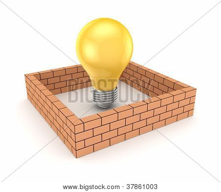 Yelow lamp behind brick wall.