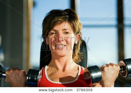 Mature Woman Lifting Dumbbells