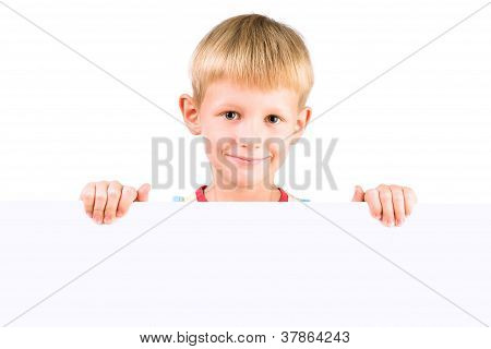Handsome Boy 5-6 Years Old Holding Blank Poster Isolated Over White