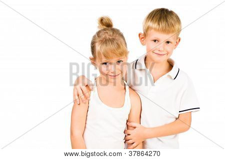 Portarit Of Smiling Boy Hugging His Girlfriend  Isolated Over White