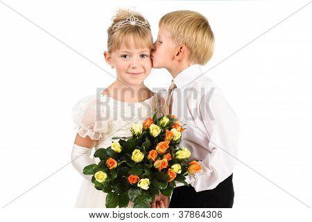 5-7 Years Old Boyl Kissing A Beautiful Girl, Studio Shot, Formal Wear