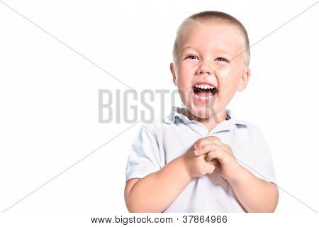 Portrait Of Excited Little Boy Laughing Isolated Over White
