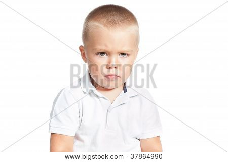 Portrait Of Little Upset Boy Isoalted Over White