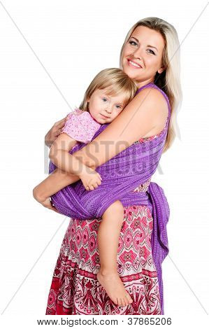 Happy Mother Hugging With Little Girl In Sling Isolated On White Background