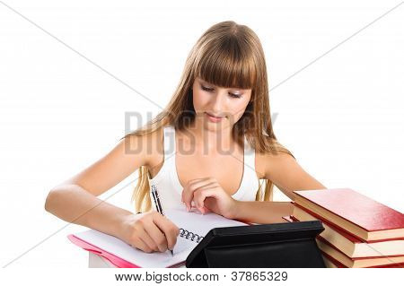 Teen Girl learning At The Desk Isolated On White