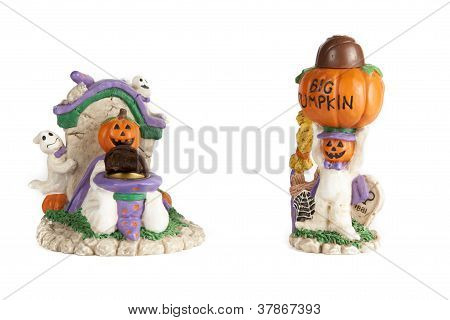 Halloween pumpkin head mummies with chocolates