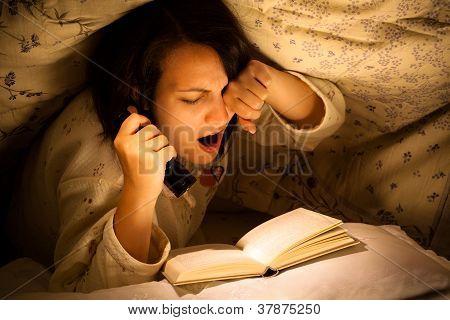 Yawning Woman Reading a Book