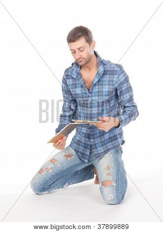 Man Reading A Tablet Pad
