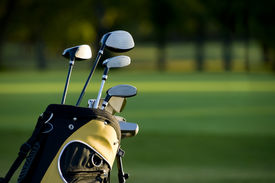 stock photo of golf bag  - A set up new golf clubs on a beautiful golf course - JPG