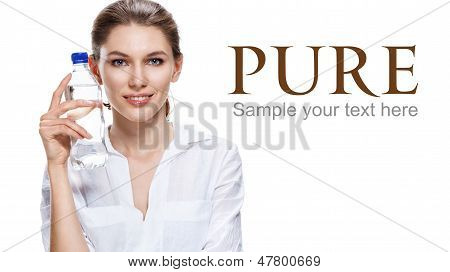 pleased european brunette woman & a bottle of clear water - isolated on white background