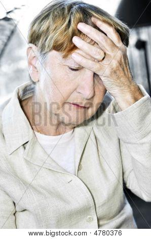 Elderly Woman Holding Head