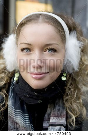 Portrait Young Blond Curl Girl With Blue Eyes