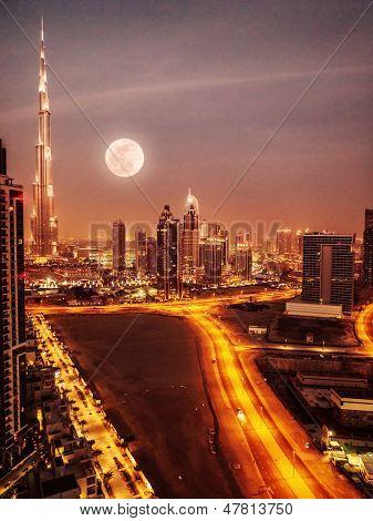 Dubai in moonlight, UAE, full moon, night scape in Dubai downtown, modern Arabian architecture, middle east, illuminated city at night, luxury vacation