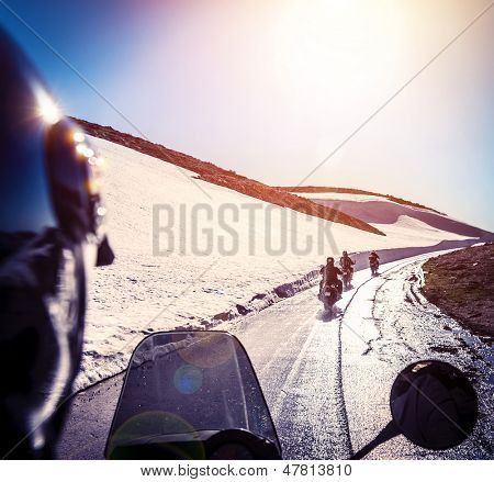 Group of bikers on snowy road, active lifestyle, adventure trip, extreme  moto sport, off-road transport, race competition, speed concept