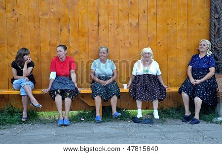 Villagers resting on a bench