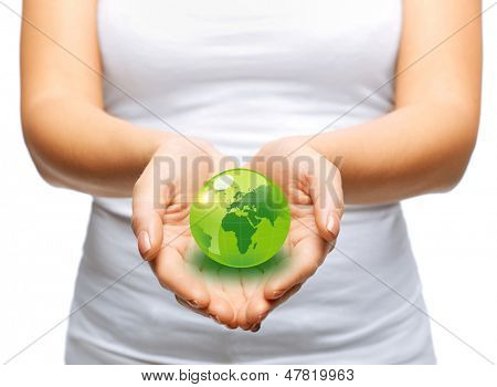 environment and technology concept - woman hands holding green sphere globe