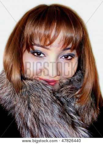 Beautiful girl in fur coat
