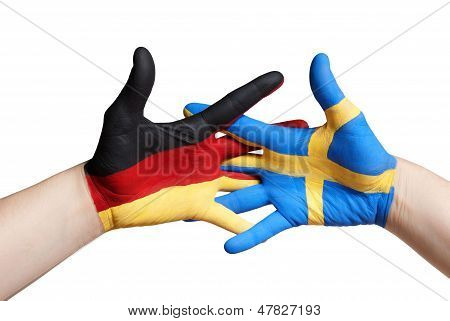 A Swedish And A German Painted Hand