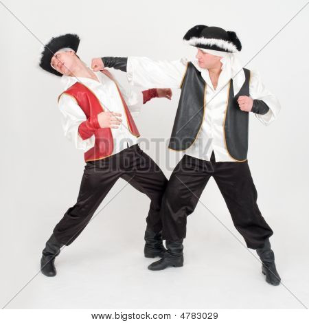 Fight. Two Boys In Pirate Costumes.