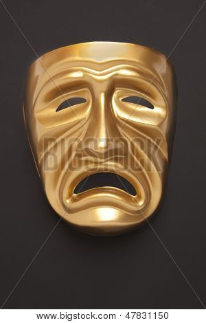 Tragedy theatrical mask on a black background
