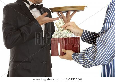 Giving a bribe. Dollar banknotes. White background