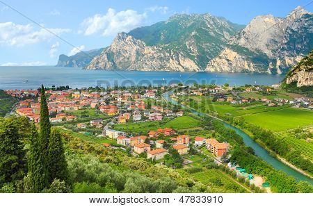 The Lake Garda (Lago di Garda or Lago Benaco) and The Nago - Torbole city. Italian largest lake is located in Northern Italy.