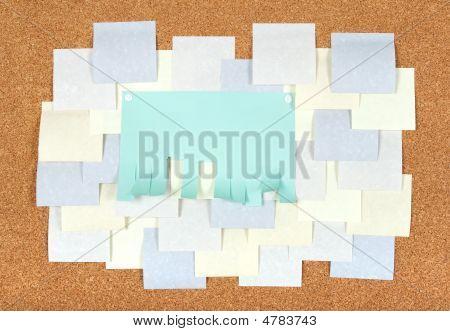 Many Blank Ads On Corkboard