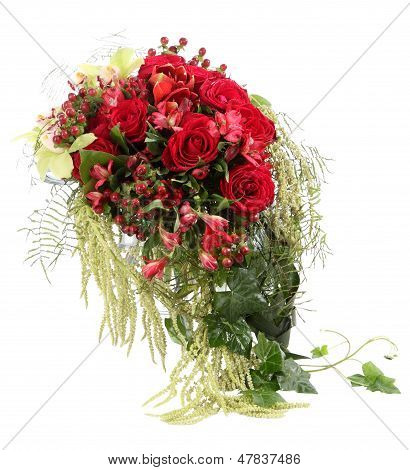 Flower Arrangement With Red Roses And Decorative Hypericum. Floral Composition. Isolated on white