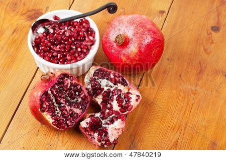 Pomegranate Fruit And Pips In A White Bowl