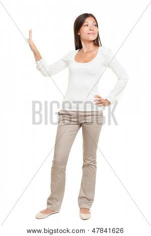 Full length of young woman with hand on hip making stop gesture isolated over white background
