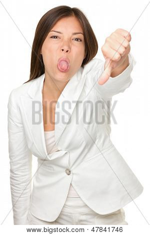 Portrait of businesswoman sticking out tongue while gesturing thumbs down isolated over white background