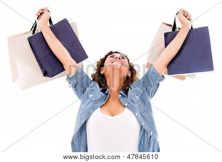 Excited shopping woman with arms up - isolated over white background