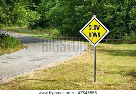 Slow Down yellow traffic sign