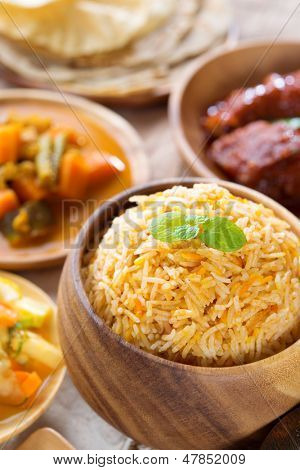 Biryani rice or pilaf rice with curry, fresh cooked basmati rice with spices, delicious Indian food.