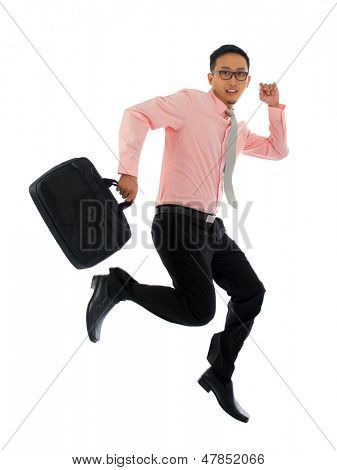 Full body young attractive Asian businessman in hurry running or jumping up with a briefcase, isolated on white background