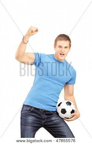 Euphoric fan holding a soccer ball and cheering isolated on white background