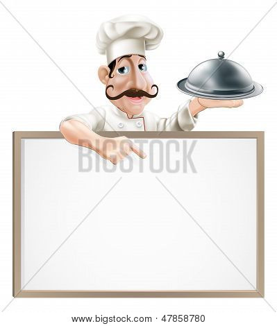 Chef With Platter Pointing At Sign