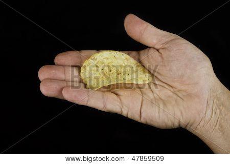 Hand Holding One Potato Chip