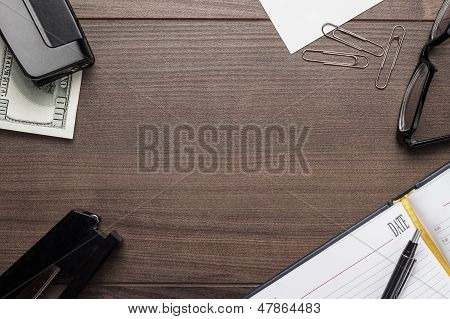 office brown wooden table with some objects