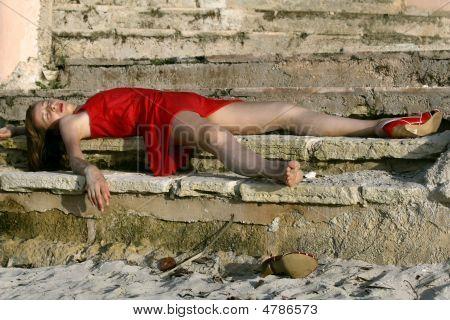 Senseless Woman On The Floor