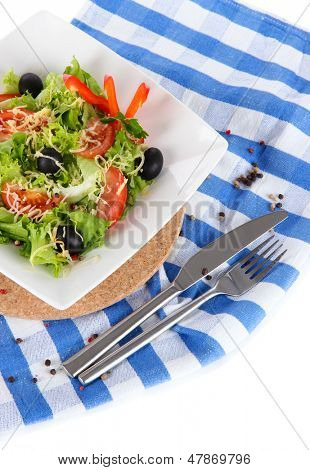 Light salad on plate on napkin