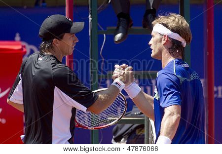 BARCELONA - APRIL, 23: Argentinian Carlos Berlocq and Spanish Gimeno-Traver greet each other after his match against match of Barcelona tennis tournament Conde de Godo on April 23, 2013 in Barcelona