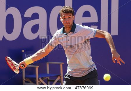 BARCELONA - APRIL, 24: Bulgarian tennis player Grigor Dimitrov in action during a match of Barcelona tennis tournament Conde de Godo on April 24, 2013 in Barcelona