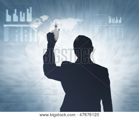 Incognito businessman and the high tech type modern display over the virtual background
