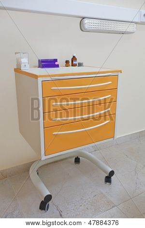 The image of a medical movable bedside-table