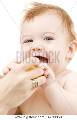Baby Boy With Yellow Plastic Toy