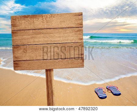 wood sign on beach