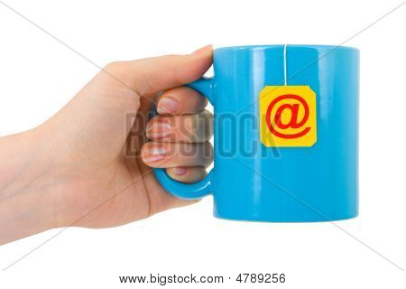 Hand And Cup Of Tea With E-mail Symbol